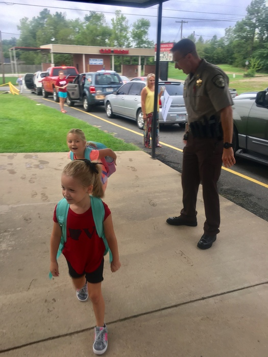 Garland county Under-sheriff Jason Lawerance welcomes back to school CMS elementary students
