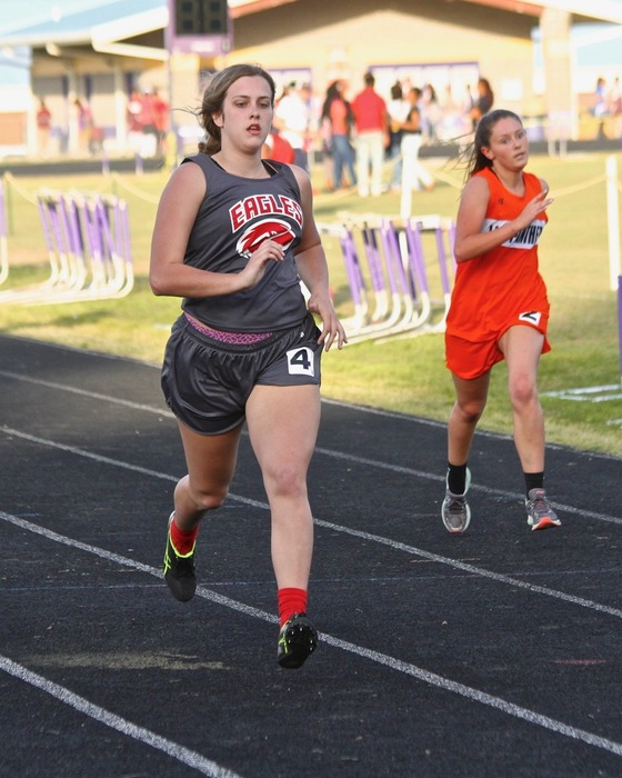 Kara running the 400 at Gurdon Track meet.
